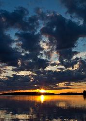 Sonne über dem See Lentua, Finnland  2